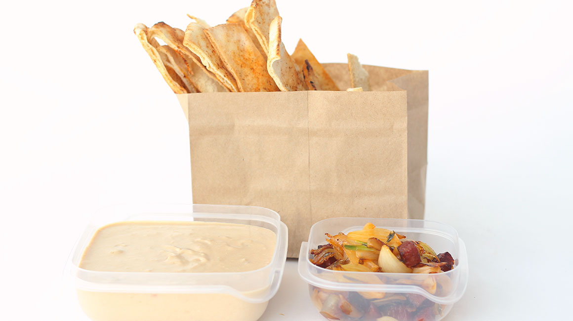 Beans with pork and crème fraîche dip with spicy pita chips
