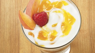 Peach jam, granola and yogurt parfait