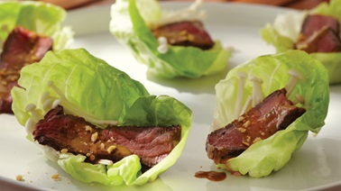 Grilled bison & enoki mushroom lettuce rolls with peanut sauce