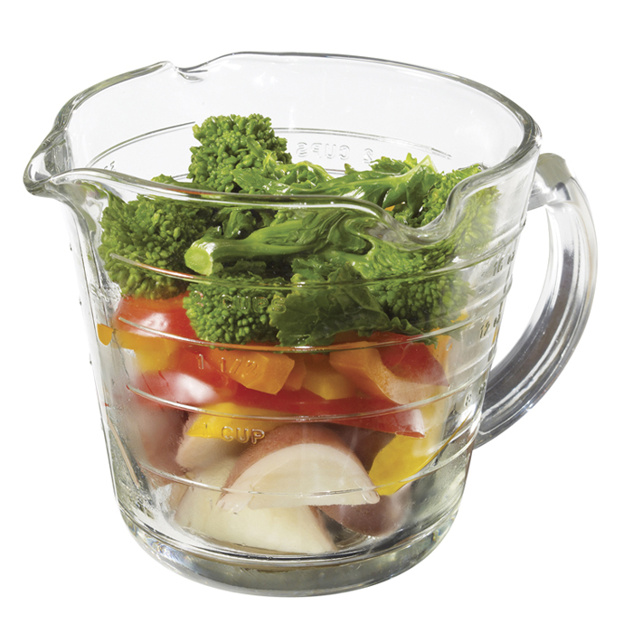 Fruits and vegetables in a measuring cup