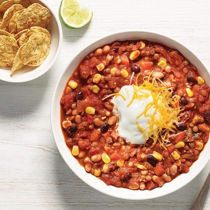 Vegetarian Chili + cheese + sour cream + chips